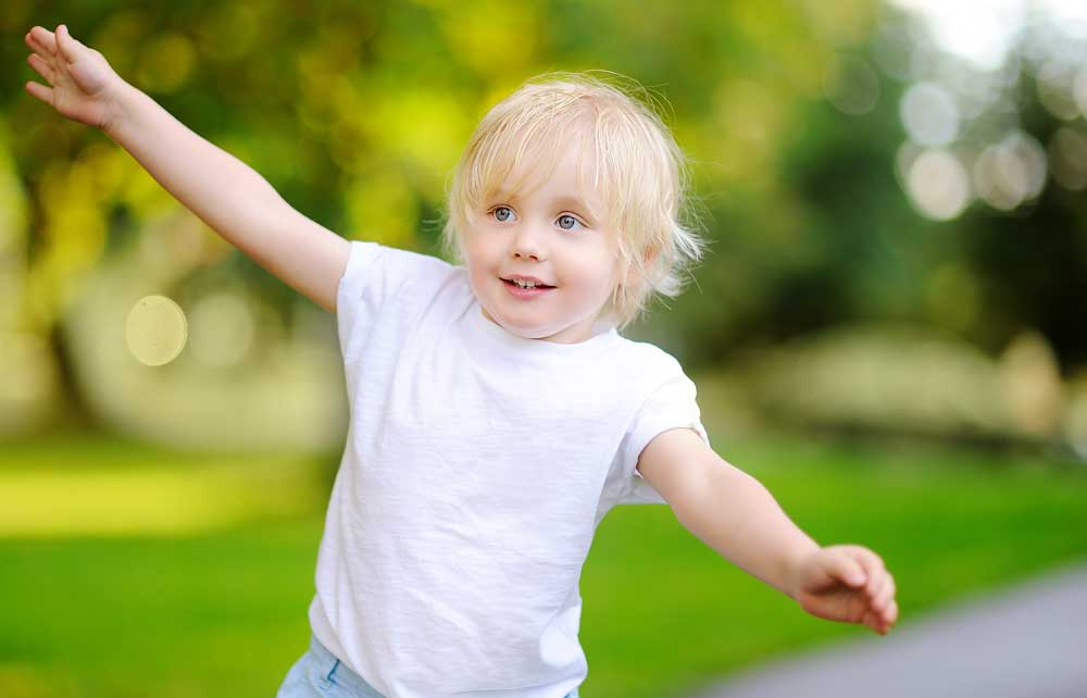 A Happy Child Running Freely by Waving Hands