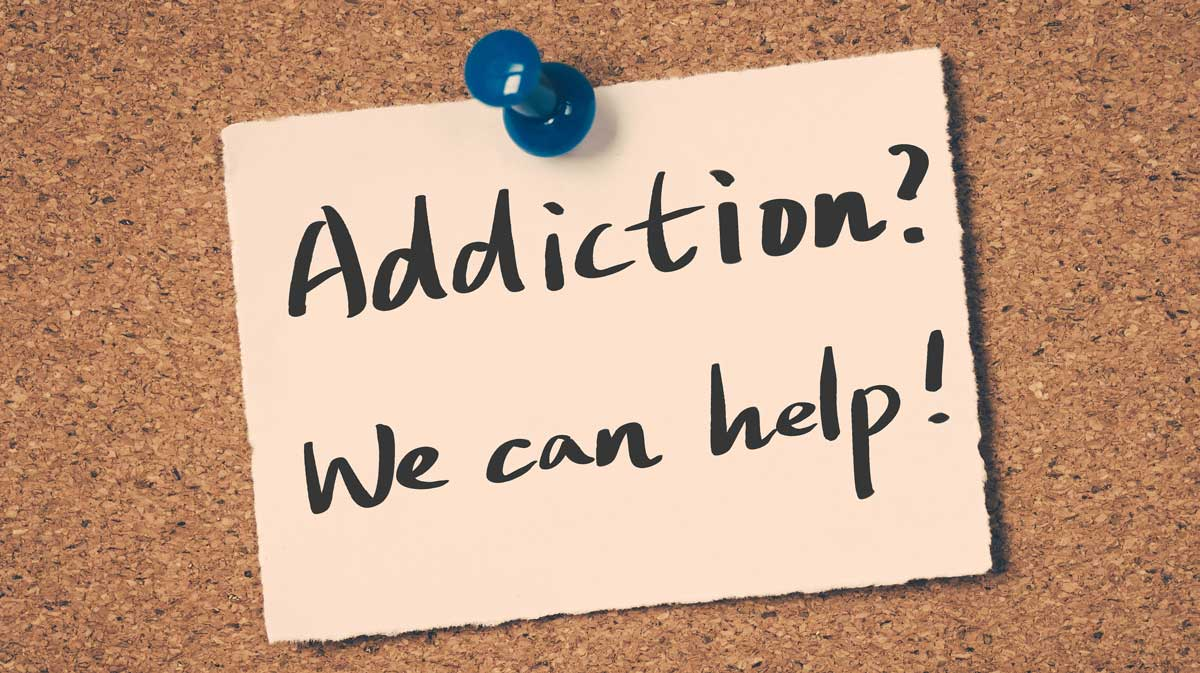 Addiction? We can help! on a pin board